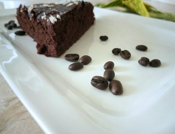 Delicious coffee beans and chocolate cake